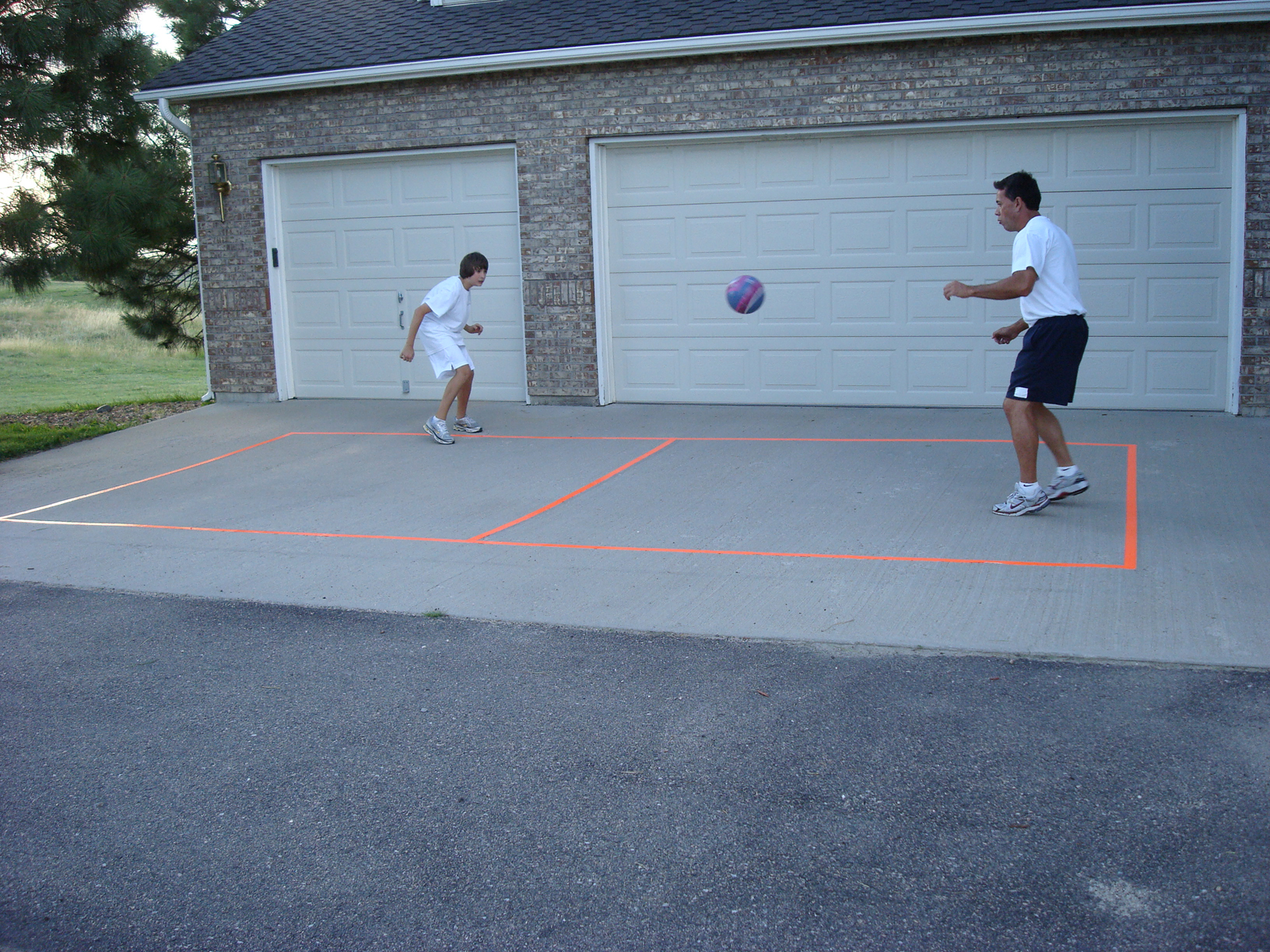 Father and Son Playing in Driveway